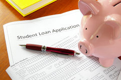 Student loan. Application and piggy bank stock images
