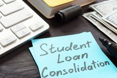 Student loan consolidation Money on a table. stock photos