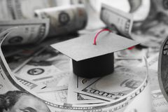 Student Loan Debt With College Graduation Cap On Money In Black & White. High Quality Stock Photo stock images