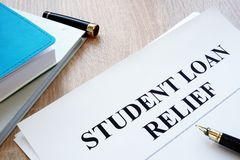 Student loan relief papers on a desk. stock photo