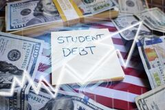 Student Loan Tuition Debt In The United States Concept With Borrowed Money On The American Flag Accumulating Crazy Interest Debt