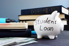 Student loan written on a piggy bank and money. royalty free stock photography