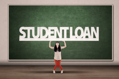 Student Loans Concept. Young asian college student hold a sign of student loan Royalty Free Stock Images