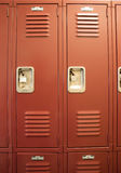 Student Lockers University School Campus Hallway Storage Locker. A row of locked starage lockers vertical composition royalty free stock photos