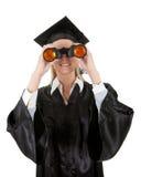 Student looking through binoculars Stock Photo