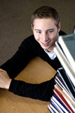 Student Looking At Book Stack Stock Images