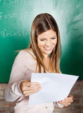 Student Looking At Exam Result In Classroom Stock Image