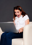 Student looking at laptop and shouting Royalty Free Stock Photography