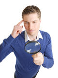 Student looking through a magnifying glass Stock Images