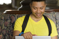 Student looks at a laptop screen. A student looks down at a laptop screen Royalty Free Stock Images