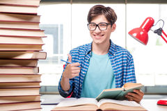 The student with lots of books preparing for exams Stock Photo