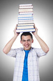 Student with lots of books Royalty Free Stock Photos