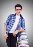 Student with lots of books on white Stock Image