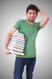 Student with lots of books on white Royalty Free Stock Images