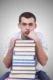 Student with lots of books on white Royalty Free Stock Photography