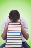 Student with lots of books on white Royalty Free Stock Photos
