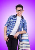 The student with lots of books on white Stock Images