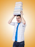 The student with lots of books on white Stock Photography