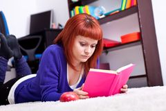 Student lying with book Royalty Free Stock Images