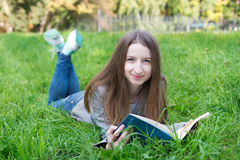 Student lying on grass Royalty Free Stock Images