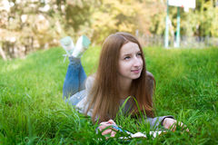 Student lying on grass and thinking Royalty Free Stock Images