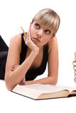 Student is lying and reading book Royalty Free Stock Photography