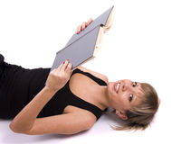 Student is lying and reading book Stock Photo
