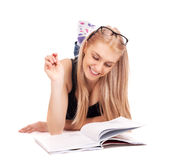 Student lying and studying Royalty Free Stock Photography