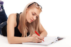 Student lying and studying Stock Photo