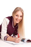 Student lying and studying Stock Photography