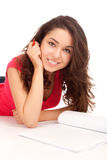 Student lying and studying Stock Image
