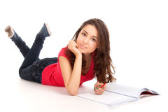Student lying and studying Stock Images