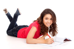 Student lying and studying Royalty Free Stock Photos
