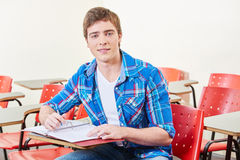 Student makes his homework Stock Image
