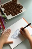 A student makes lessons. School supplies. royalty free stock image