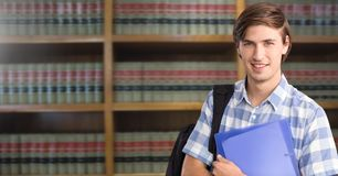 Student man in education library. Digital composite of Student man in education library stock images
