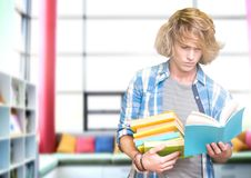 Student man in education library. Digital composite of Student man in education library stock photo
