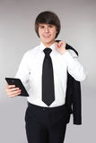 Student man holding smart phone. Confident handsome teen smiling Royalty Free Stock Photography
