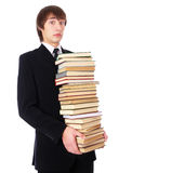 Student with many books is shocked. Isolated at white background Stock Photos