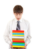 Student with Many Books. Student stand with Many Books Isolated on the White Background Stock Photography