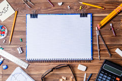 Student material with copybook for text on wooden table. Stock Photography