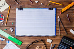 Student material with copybook for text on wooden table. Royalty Free Stock Photography