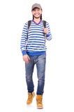 Student med den isolerade ryggsäcken Royaltyfri Fotografi
