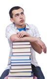 Student med massor av böcker Arkivfoton