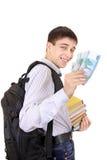 Student med pengar arkivfoto