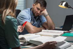 Student of medicine with headache Royalty Free Stock Photo