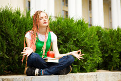 Student meditating outdoors Royalty Free Stock Photo