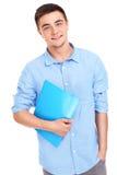 Student met dossiers stock afbeelding