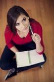 Student met notitieboekje Stock Afbeelding