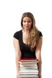 Student met stapel van boeken Stock Fotografie